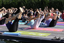 Yoga in action outdoors - verywellbeing.co.uk