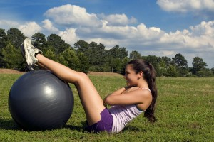 15252-a-young-woman-stretching-outdoors-before-exercising-pv