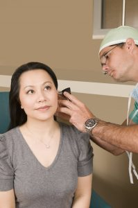 doctor-examining-a-female-patient-pv
